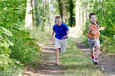 """Young Children Running In Nature"" by chrisroll"