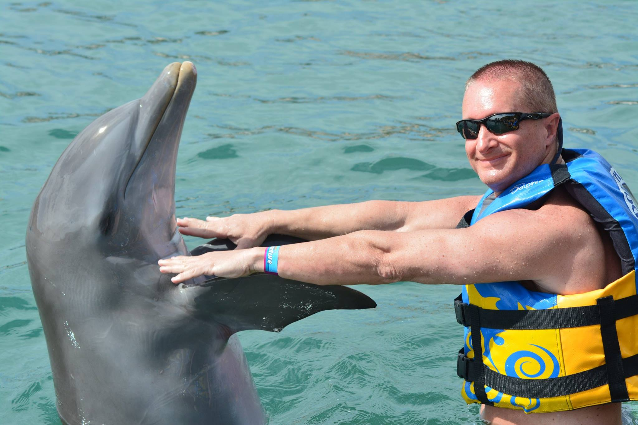 Jeff Buffo swims with dolphins